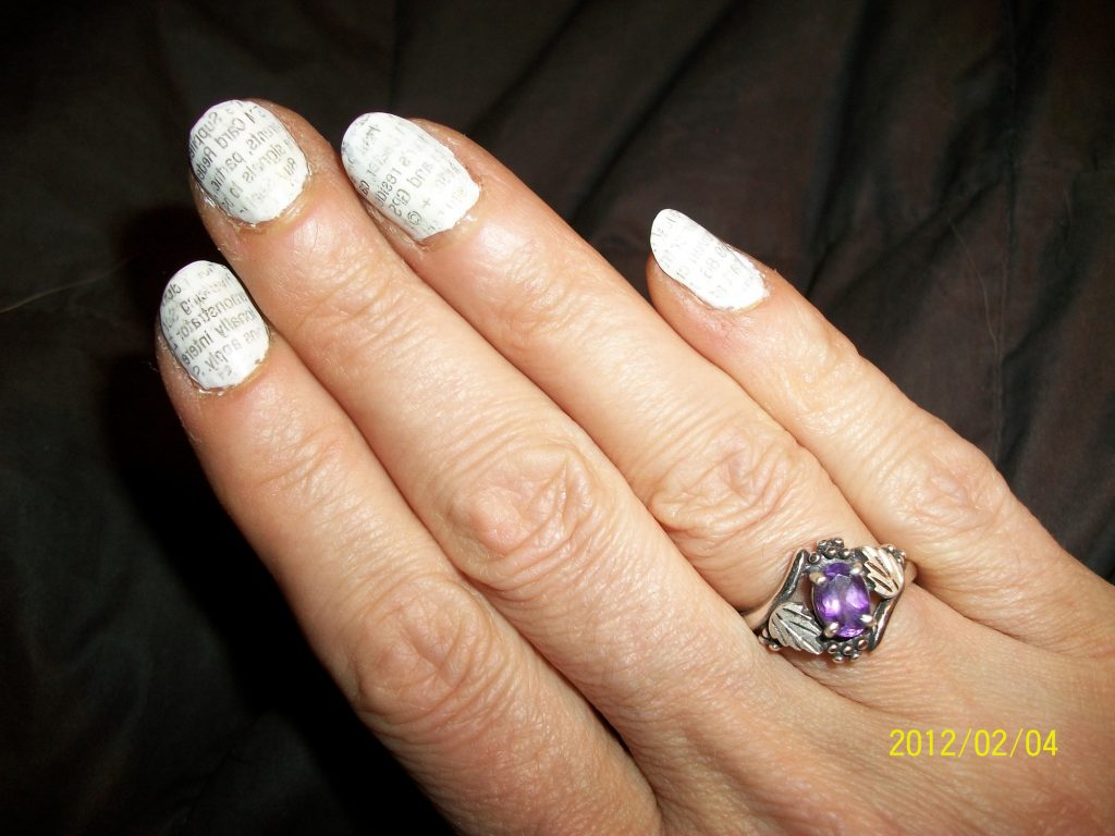 Amethyst ring and newsprint nails
